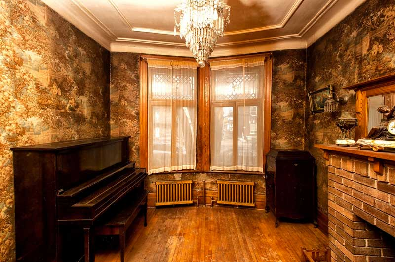 This Home Has Got To Be Haunted While It Needs A SERIOUS Amount Of TLC The Woodwork Is Die For Check Out Interior Doors And Those Chandeliers